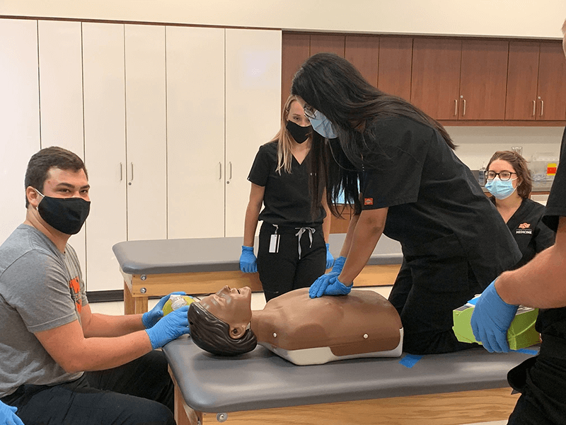 OSU-COM students in Tulsa tackle Basic Life Support Training.