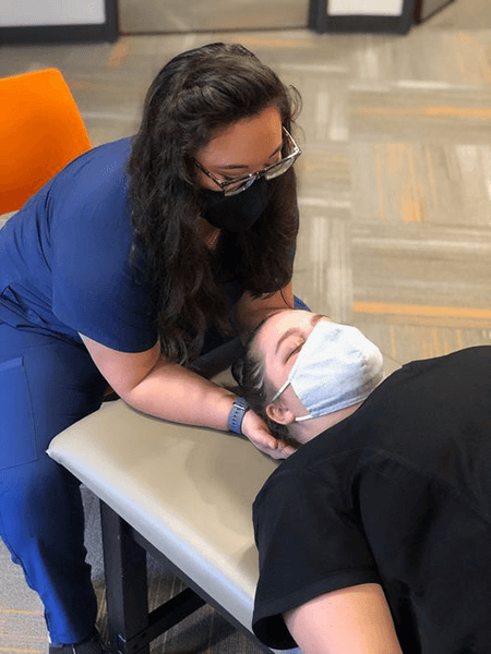 First-year medical student, Becca, practices her OMM skills.